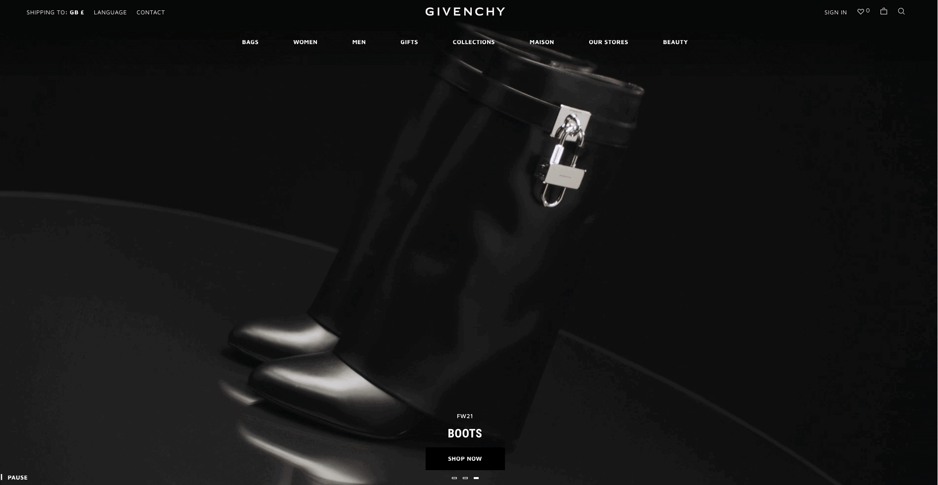 The Givenchy home page. Most of the page is taken up by white space in the form of a photograph of a pair of boots. There is a simple navigation bar at the top of the page with white text on a black background.